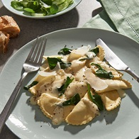 Ricotta Spinach And Parmesan Agnolotti In A Creamy Cheese Sauce