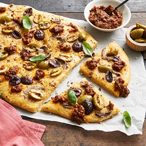 Sundried Tomato Pizza With Anchovies And Olives